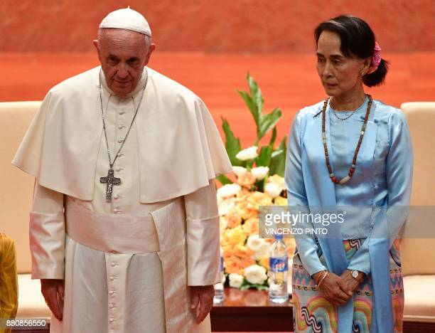 Pope Francis stands beside Myanmar's civilian leader Aung San Suu Kyi during an event in Naypyidaw on November 28 2017 Pope Francis held talks with...