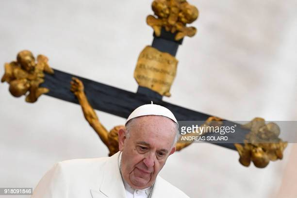 TOPSHOT Pope Francis stands in front of a crucifix as he looks on during his weekly general audience at St Peter's Square at the Vatican on February...