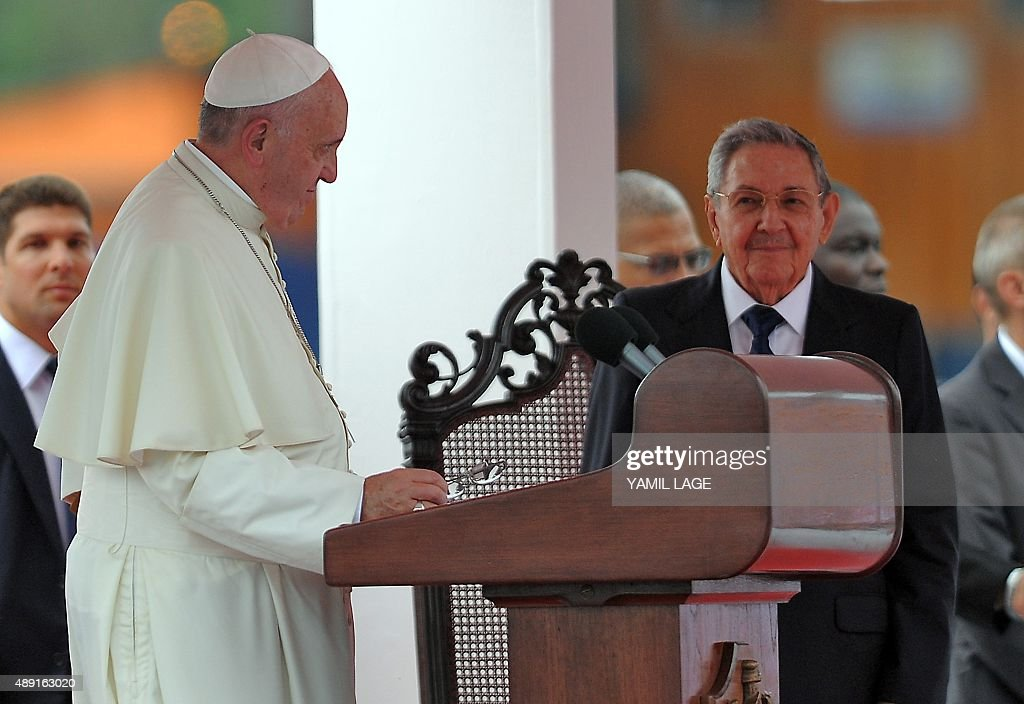 Pope Francis (L) stands next to Cuban President Raul Castro during his welcome ceremony upon landing at Havana's international airport on September 19, 2015, on the first leg of a high-profile trip that will also take him to the United States. AFP PHOTO / Yamil Lage