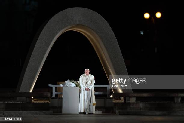 Pope Francis stands next to the Memorial Cenotaph as he observes a one minute silence in memory of the victims of the Hiroshima atomic bomb during...