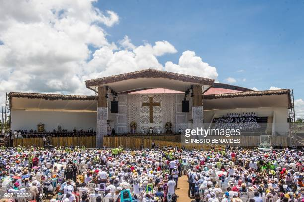 Pope Francis stands on the stage during a meeting with thousands of faithfuls in the Peruvian city of Puerto Maldonado on January 19 2018 Pope...