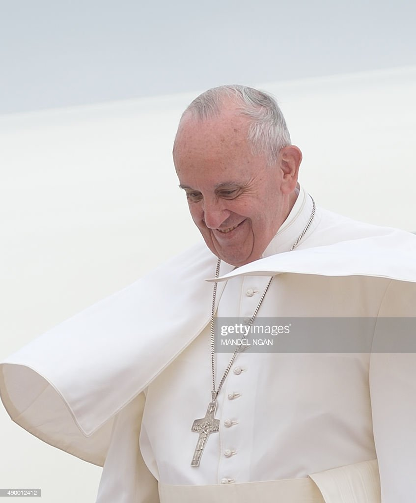 Pope Francis steps off his plane upon arrival at Andrews Air Force Base in Maryland on September 22, 2015.