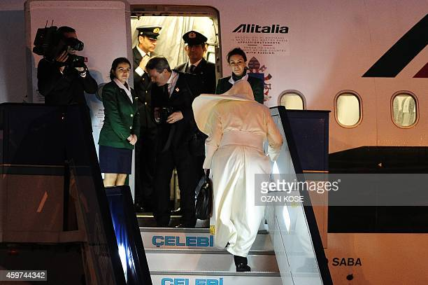 Pope Francis steps on plane to leave Turkey after a threeday visit on November 30 2014 Pope Francis joined forces today with Orthodox Ecumenical...