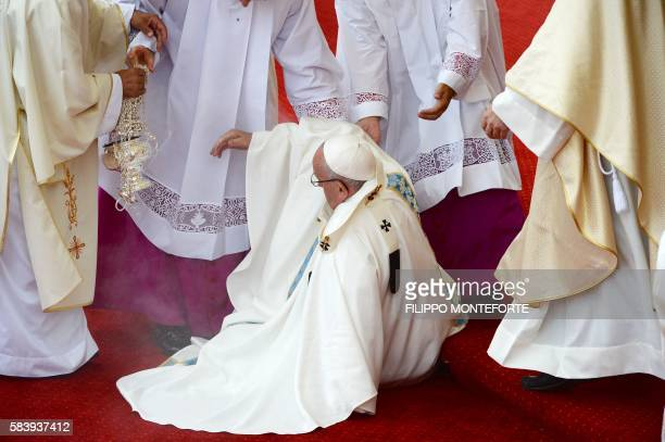 Pope Francis takes a fall during a mass at the Jasna Gora Monastery in Czestochowa Poland on July 28 2016 Pope Francis visits Poland for an...