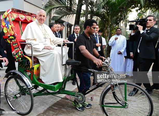 TOPSHOT Pope Francis takes a ride in a rickshaw during the second day of his visit to Bangladesh in Dhaka on December 1 2017 Pope Francis arrived in...