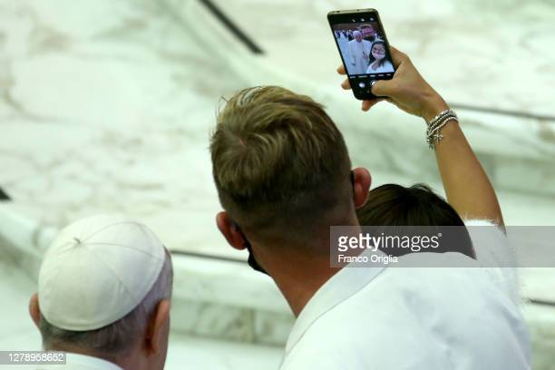 Pope Francis takes a selfie with pilgrims during his Wednesday General Audience at Paul VI Hall on October 07, 2020 in Vatican City, Vatican. Pope...