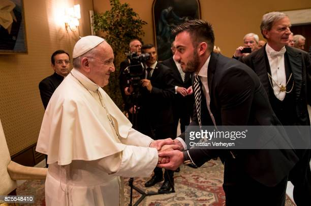 Pope Francis talks to Josip Drmic during a private audience with his team of Borussia Moenchengladbach in the Palace of the Vatican on August 02 2017...