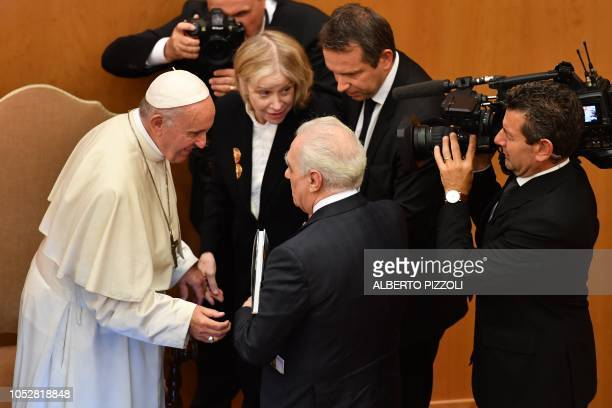 Pope Francis talks with US director Martin Scorsese and his wife Helen Morris within an intergenerational dialogue themed The Wisdom of Time with...