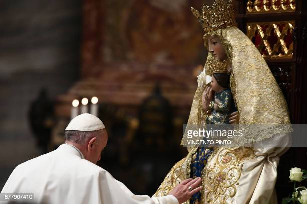 Pope Francis touches a statue of the Virgin Mary during a prayer for Peace in South Sudan and the Democratic Republic of Congo on November 23 2017 at...