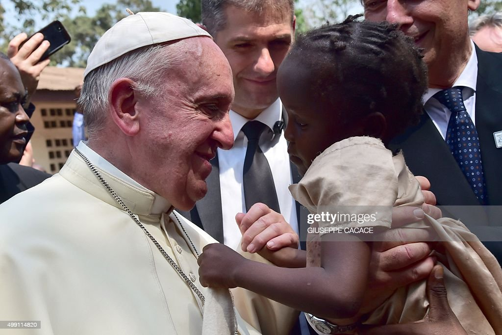 Pope Francis touches children in a refugee camp on November 29, 2015 in Bangui. Pope Francis arrived as 'a pilgrim of peace' in conflict-ridden Central African Republic on November 29, flying in from Uganda on what will be the most dangerous destination of his three-nation Africa tour.