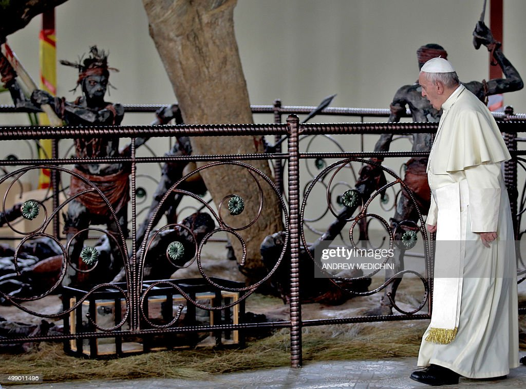 Pope Francis visits the Namugongo Martyrs' Shrine in Namugongo, Uganda, on November 28, 2015. Pope Francis arrived in Uganda on November 27 on the second leg of a landmark trip to Africa which has seen him railing against corruption and poverty, with huge crowds celebrating his arrival.