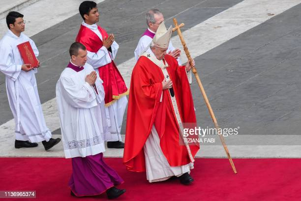 Pope Francis walks across St Peter's square during the Palm Sunday mass on April 14 2019 in the Vatican