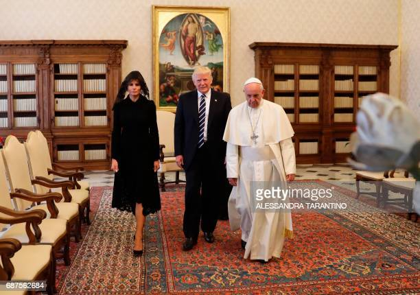 Pope Francis walks along with US President Donald Trump and US First Lady Melania Trump during a private audience at the Vatican on May 24 2017 US...