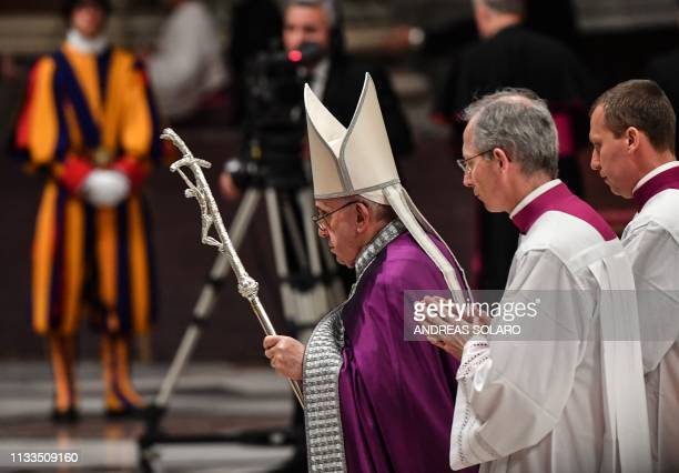 Pope Francis walks at the end of a penitential liturgy mass on the Friday of the Third Week of Lent, on March 29, 2019 at St. Peters Basilica in the...