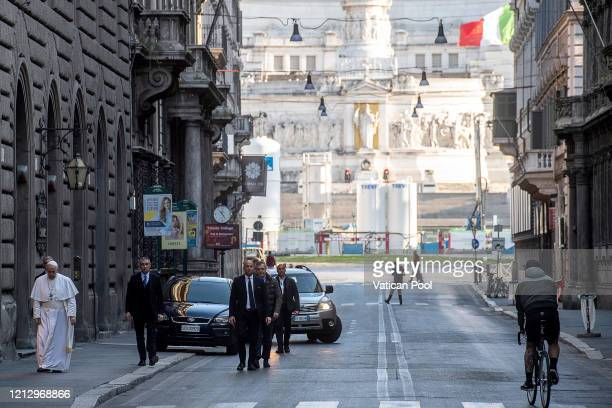 Pope Francis walks in a desert Via Del Corso as he leaves the church of San Marcello on the Corso where a miraculous crucifix is housed on March 15...