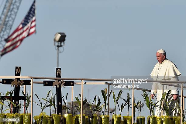 Pope Francis walks on stage at the US border before celebrating mass at the Ciudad Juarez fairgrounds on February 17 2016 Throngs gathered at...