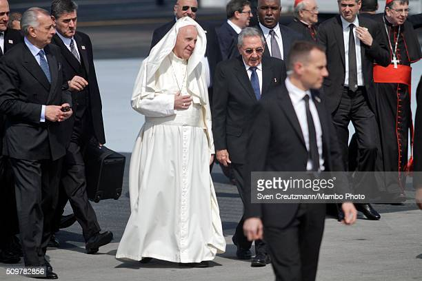 Pope Francis walks on the tarmac next to Cuba's president Raul Castro upon his arrival in Cuba, on February 12 in Havana, Cuba. Pope Francis met with...