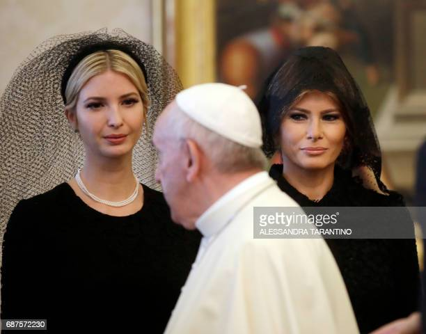 TOPSHOT Pope Francis walks past US First Lady Melania Trump and the daughter of US President Donald Trump Ivanka Trump at the end of a private...