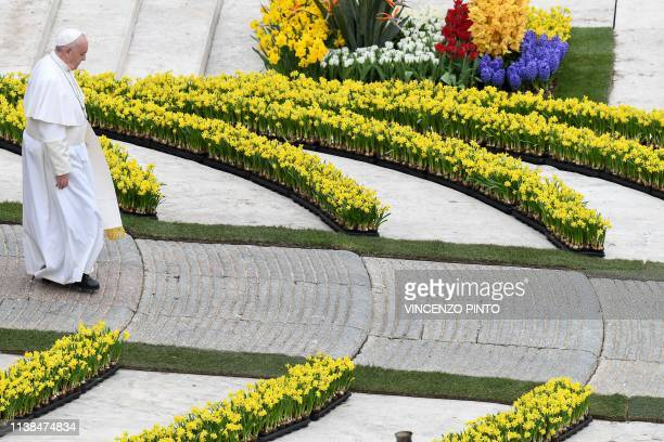 Pope Francis walks through flower arrangements down the esplanade at the end of the Easter Sunday mass on April 21 2019 at St Peter's square in the...