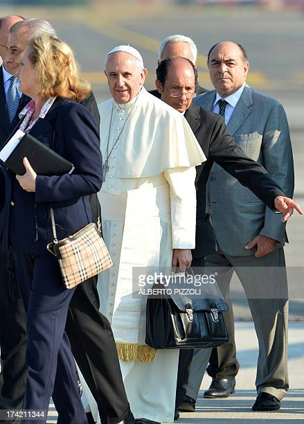 Pope Francis walks to board a plane on July 22 2013 at Rome's Fiumicino airport on his way to his first overseas trip to Brazil for World Youth Day...
