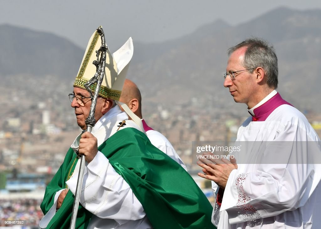 Pope Francis walks to the altar to celebrate mass at the Las Palmas air base in Lima on January 21, 2018. Pope Francis was preparing to wrap up his Latin American trip on Sunday with a mass at the air base where a million faithful were expected to hear him speak. On the last day of a week-long trip that has taken him to six cities in Chile and Peru, the 81-year-old pontiff began the day by delivering a homily to 500 nuns, as well as meeting the bishops of Peru. PHOTO / Vincenzo PINTO