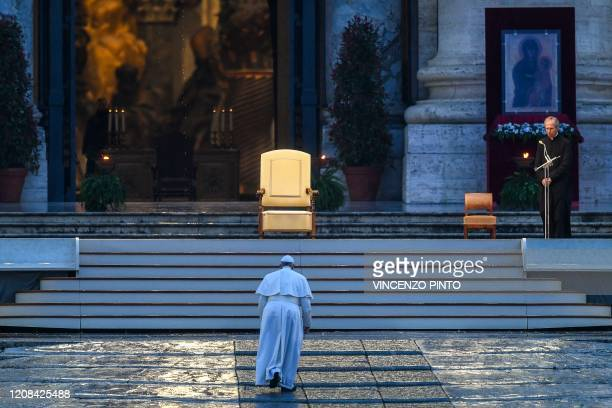TOPSHOT Pope Francis walks towards the platform to preside over a moment of prayer on the sagrato of St Peters Basilica the platform at the top of...