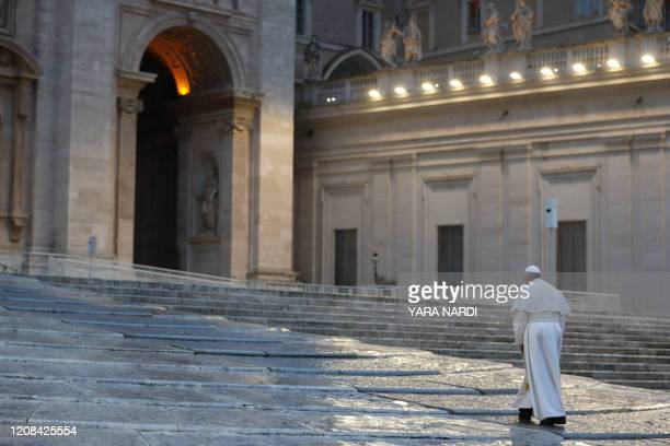 Pope Francis walks towards the platform to preside over a moment of prayer on the sagrato of St Peters Basilica, the platform at the top of the steps...