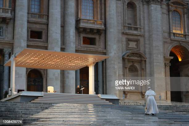 Pope Francis walks towards the platform to preside over a moment of prayer on the sagrato of St Peters Basilica the platform at the top of the steps...