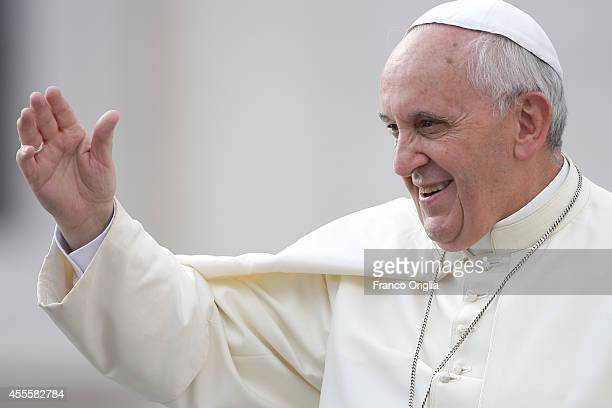 Pope Francis waves as he arrives at St Peter's Square for his weekly audience on September 17 2014 in Vatican City Vatican Speaking on Wednesday...