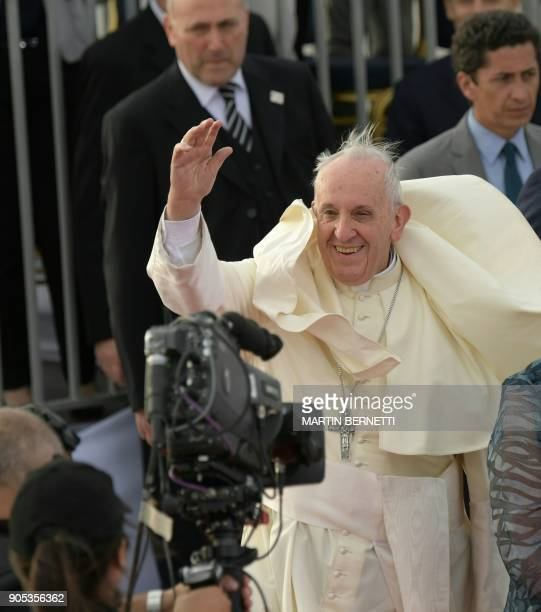 Pope Francis waves as he arrives at the Arturo Merino Benitez airport in Santiago on January 15 2018 Pope Francis is visiting Chile from January 15...