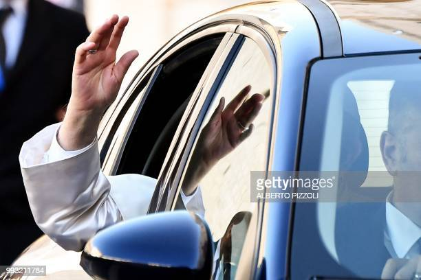 Pope Francis waves as he arrives for a meeting with religious leaders at the Pontifical Basilica of St Nicholas in Bari in the Apulia region in...