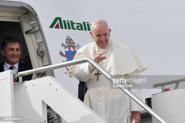 Pope Francis waves as he boards a plane at Fiumicino airport on February 3 on his way to a threeday visit to the United Arab Emirates The United Arab...