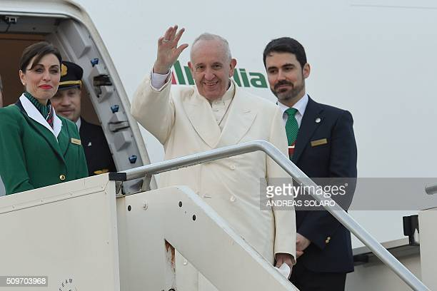 Pope Francis waves as he boards a plane to Cuba for a historic meeting with Russian Patriarch Kirill before his trip to Mexico for a fiveday visit on...
