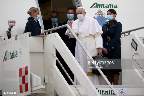 Pope Francis waves as he departs for his trip to Iraq from Leonardo Da Vinci airport on March 05, 2021 in Rome, Italy. Pope Francis will start the...
