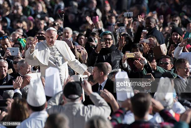 Pope Francis waves as he is driven through the crowd in St Peter's Square for his weekly general audience at the Vatican Wednesday Nov 9 2016