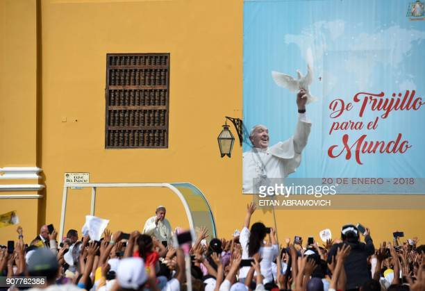 Pope Francis waves at the crowd as he passes in the popemobile through the streets of the Peruvian city of Trujillo on January 20 2018 Pope Francis...