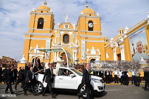 Pope Francis waves at the crowd onboard the popemobile outside the Cathedral of Trujillo in the Peruvian city of Trujillo on January 20 2018 Pope...