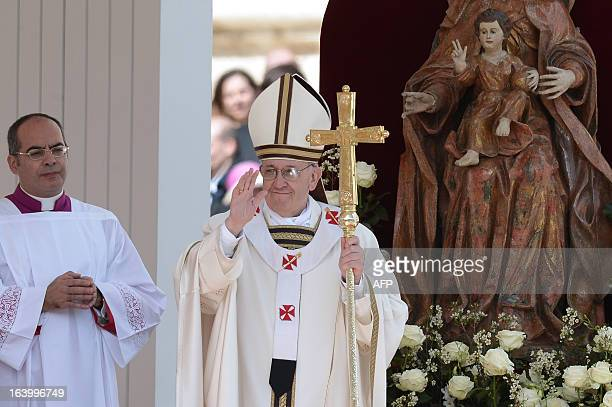 Pope Francis waves during his inauguration mass on March 19, 2013 at the Vatican. World leaders flew in for Pope Francis's inauguration mass in St...