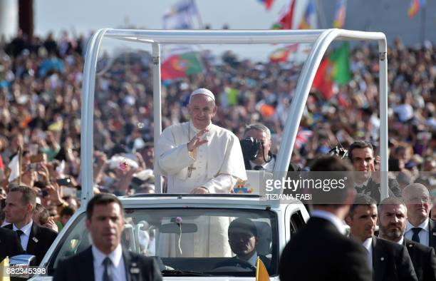 Pope Francis waves from his car upon his arrival to Fatima shrine in Fatima on May 12 2017 Two of the three child shepherds who reported apparitions...