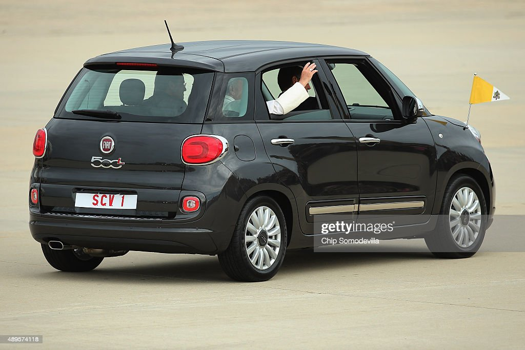 Pope Francis waves from the back of his Fiat after arriving from Cuba September 22, 2015 at Joint Base Andrews, Maryland. Francis will be visiting Washington, New York City and Philadelphia during his first trip to the United States as pope.