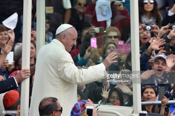 Pope Francis waves from the Popemobile as he arrives at the Simon Bolivar Park in Bogota to give an open air mass on September 7 2017 Pope Francis...