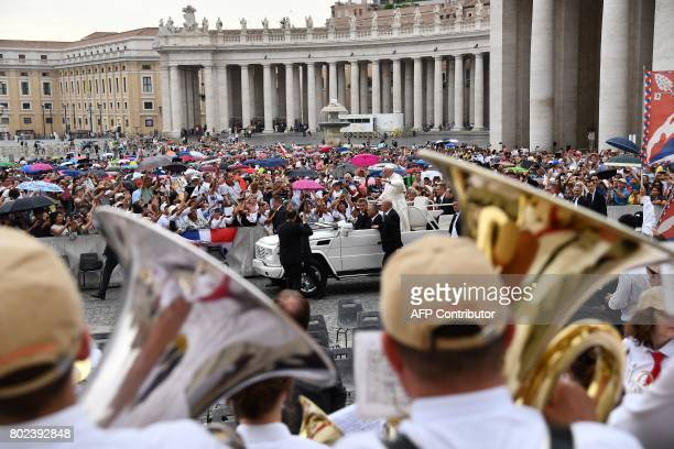 Pope Francis waves from the popemobile as he arrives for a weekly general audience at St Peter's square on June 28 2017 in Vatican / AFP PHOTO /...