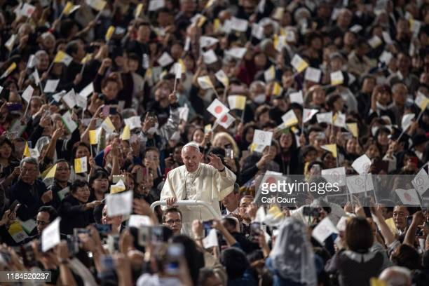 Pope Francis waves from the Popemobile as he drives around Tokyo Dome before conducting Mass on the third day of his four day visit to Japan on...