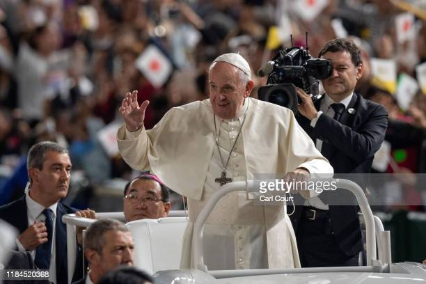 Pope Francis waves from the Popemobile as he drives around Tokyo Dome before conducting Mass on the third day of his four day visit to Japan, on...