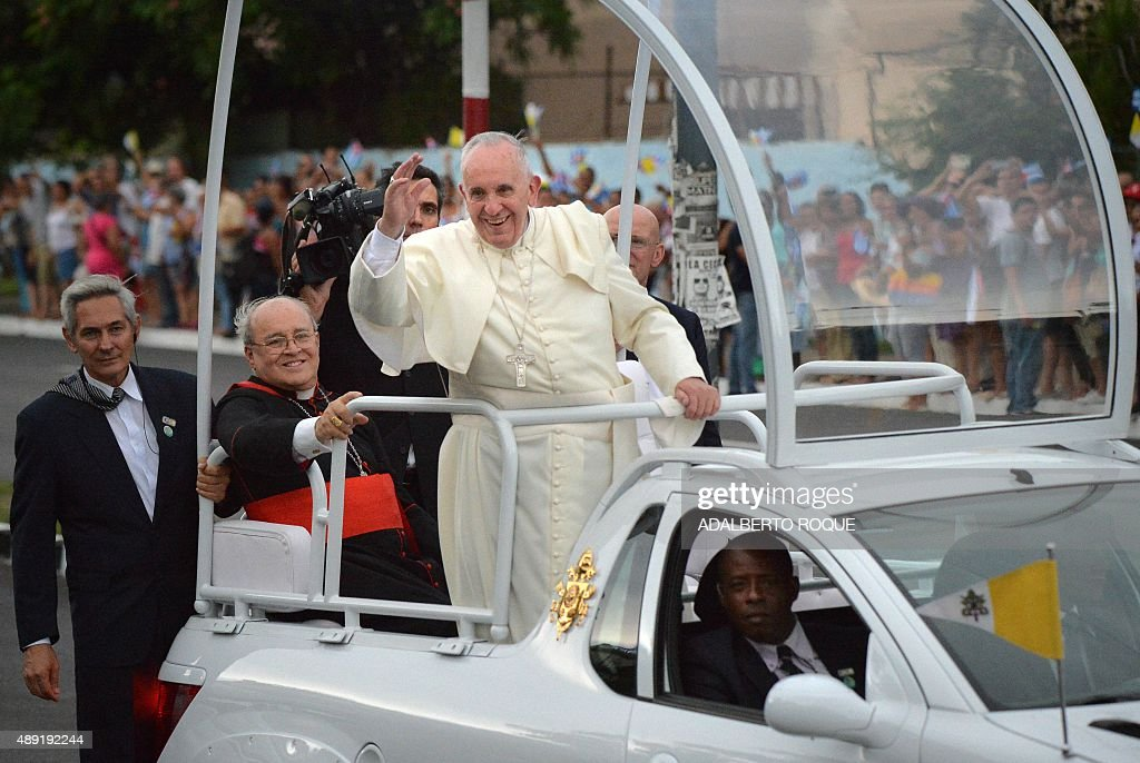 Pope Francis waves from the Popemobile as he is driven from Jose Marti airport to the Havana's downtown, on September 19, 2015. Pope Francis on Saturday urged the United States and Cuba to build on their nascent reconciliation as he arrived in Havana for the first leg of a high-profile trip that will also take him to America.