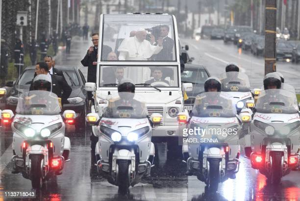 Pope Francis waves from the popemobile as he leaves RabatSale International airport near the Moroccan capital Rabat on March 30 as he begins his...