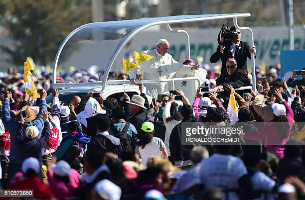 Pope Francis waves from the popemobile upon arrival in San Cristobal de las Casas, in Chiapas, for his second open-air mass, on February 15, 2016....