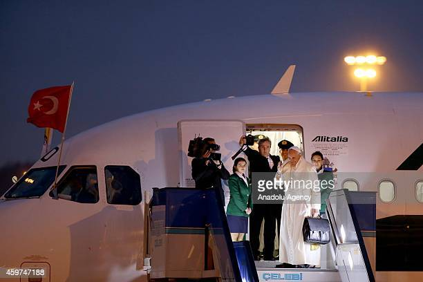 Pope Francis waves his hand ahead of he gets into the plane at the end of a threeday visit in Turkey on November 30 2014