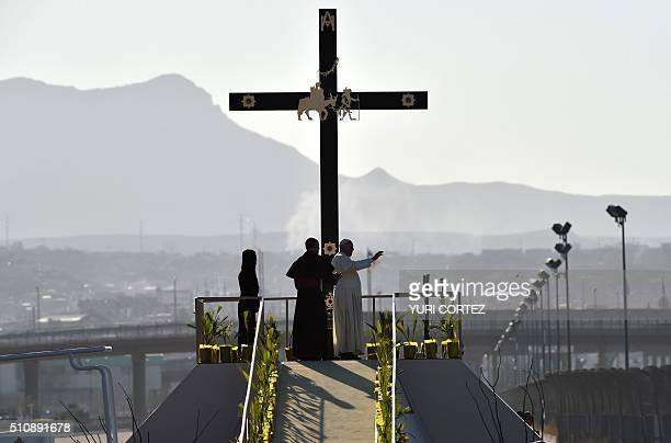 Pope Francis waves next to the US border before celebrating mass at the Ciudad Juarez fairgrounds in Chihuahua state Mexico on February 17 2016...