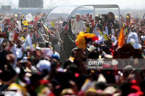 Pope Francis waves the crowd from the popemobile at Ecatepec on February 14 2016 in Ecatepec Mexico Pope Francis is on a five days visit in Mexico...